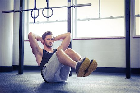 Fit man working out in studio Stock Photo - Premium Royalty-Free, Code: 6109-08397975