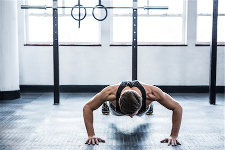 Fit man doing push ups Stock Photo - Premium Royalty-Free, Code: 6109-08397978