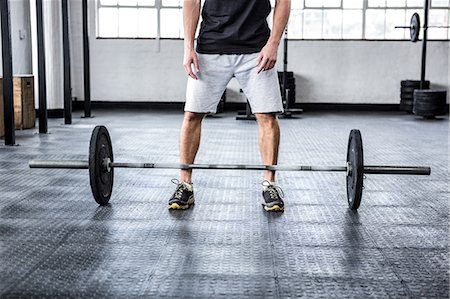 Fit man lifting heavy barbell Stock Photo - Premium Royalty-Free, Code: 6109-08397988