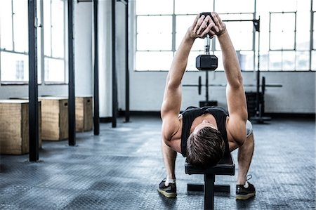Fit man lifting heavy black dumbbell Stock Photo - Premium Royalty-Free, Code: 6109-08397998