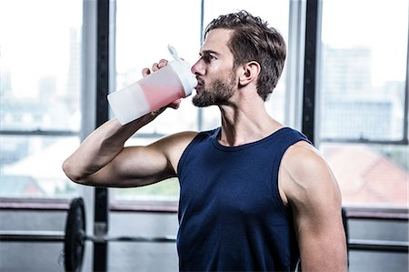 Fit man drinking his protein shake Stock Photo - Premium Royalty-Free, Code: 6109-08398040