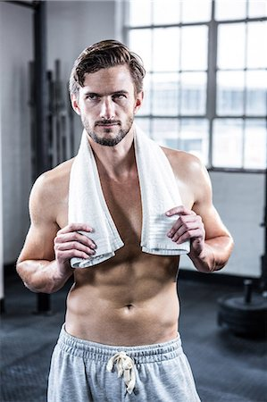 Fit shirtless man looking at camera Stock Photo - Premium Royalty-Free, Code: 6109-08398044