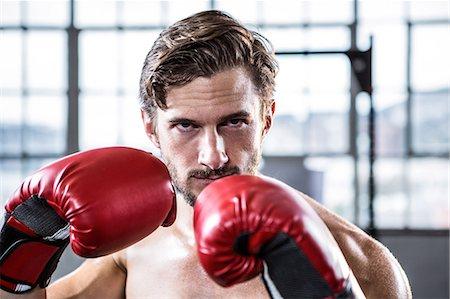 Fit shirtless man with boxing gloves Stock Photo - Premium Royalty-Free, Code: 6109-08398046