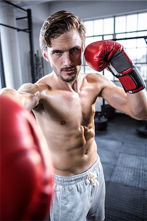 Fit shirtless man with boxing gloves Stock Photo - Premium Royalty-Free, Code: 6109-08398049