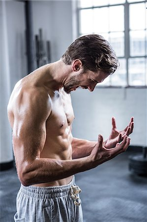 Fit shirtless man shouting and flexing Stock Photo - Premium Royalty-Free, Code: 6109-08398053