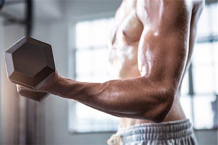 Fit shirtless man lifting dumbbells Stock Photo - Premium Royalty-Free, Code: 6109-08398063