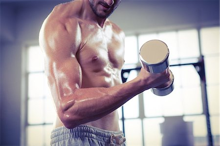 physical fitness - Fit shirtless man lifting dumbbell Stock Photo - Premium Royalty-Free, Code: 6109-08398064