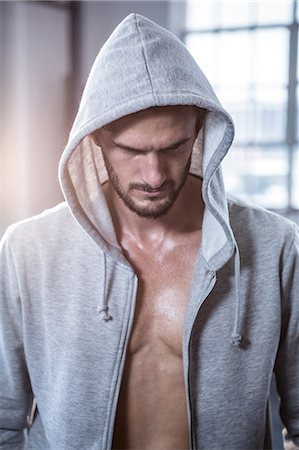 Fit shirtless man with hooded jumper Stock Photo - Premium Royalty-Free, Code: 6109-08398075