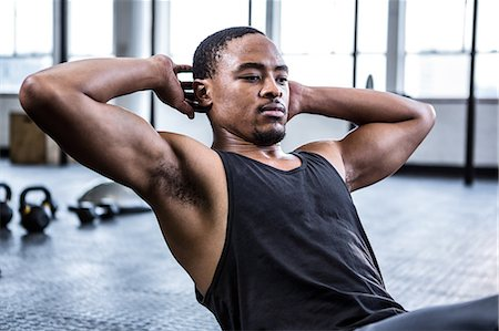 Fit man working out in studio Stock Photo - Premium Royalty-Free, Code: 6109-08398098
