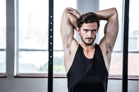 Fit man stretching his arms Stock Photo - Premium Royalty-Free, Code: 6109-08398011