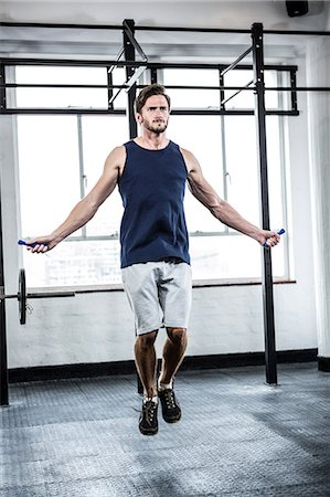 Fit man with skipping rope Stock Photo - Premium Royalty-Free, Code: 6109-08398035
