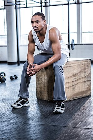Fit man taking a break from working out Stock Photo - Premium Royalty-Free, Code: 6109-08398107