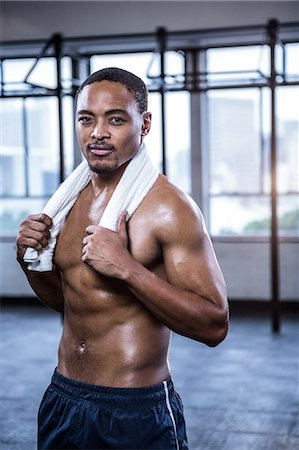 Fit shirtless man with towel on shoulders Stock Photo - Premium Royalty-Free, Code: 6109-08398121