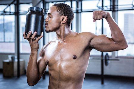 Fit shirtless man kissing protein powder Stock Photo - Premium Royalty-Free, Code: 6109-08398128