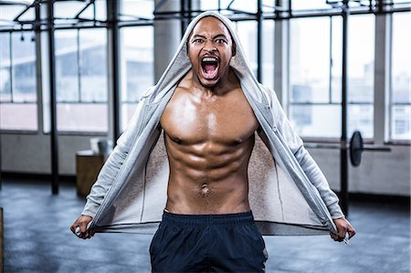 Fit shirtless man shouting at camera Stock Photo - Premium Royalty-Free, Code: 6109-08398129