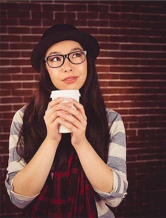 Attractive hipster holding take-away cup Stock Photo - Premium Royalty-Free, Code: 6109-08398200