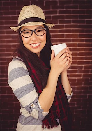 Attractive hipster holding take-away cup Stock Photo - Premium Royalty-Free, Code: 6109-08398201
