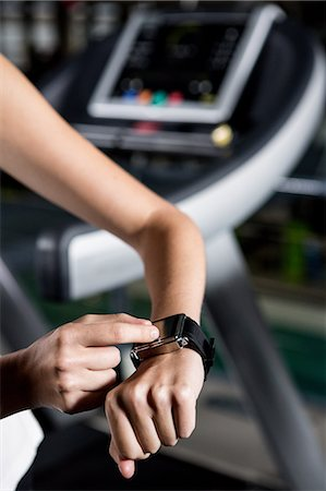 physical fitness - Woman scrolling smart watch Stock Photo - Premium Royalty-Free, Code: 6109-08398593