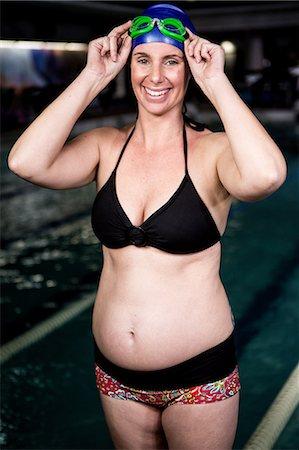 Pregnant woman smiling Stock Photo - Premium Royalty-Free, Code: 6109-08398723