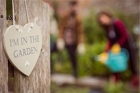 sign - Couple gardens in the background Stock Photo - Premium Royalty-Free, Code: 6109-08398975