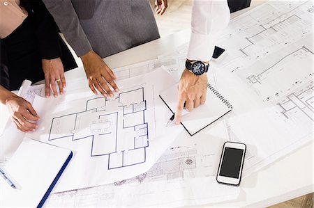 Business people discussing layouts Stock Photo - Premium Royalty-Free, Code: 6109-08399150