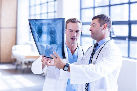 Medical team looking at x-ray together Stock Photo - Premium Royalty-Free, Code: 6109-08399359