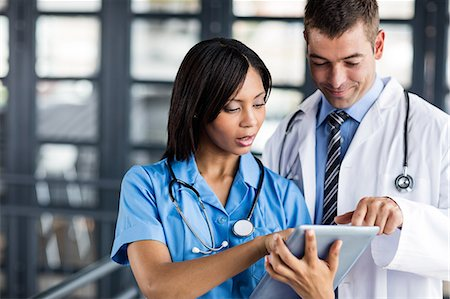 scroll - Nurse and doctor looking at a tablet Stock Photo - Premium Royalty-Free, Code: 6109-08399308