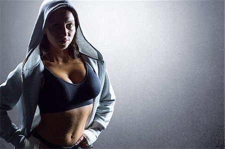 Composite image of portrait of sexy athlete in hood Stock Photo - Premium Royalty-Free, Code: 6109-08399431