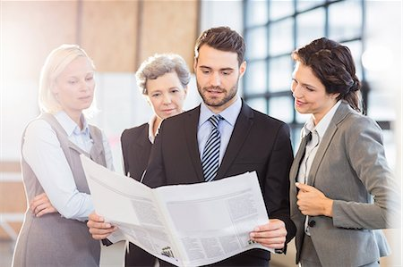 simsearch:6109-08700445,k - Business team standing and speaking at the office Stock Photo - Premium Royalty-Free, Code: 6109-08488751
