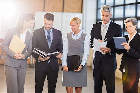 planner - Business team standing and speaking at the office Stock Photo - Premium Royalty-Free, Code: 6109-08488719