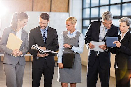 planner - Business team standing and speaking at the office Stock Photo - Premium Royalty-Free, Code: 6109-08488720