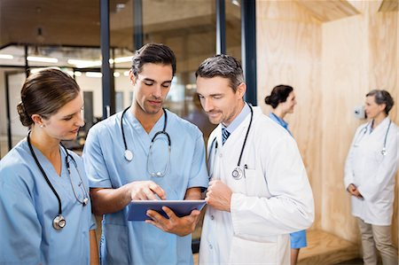 scroll - Medical team standing and talking at the hospital Stock Photo - Premium Royalty-Free, Code: 6109-08488895