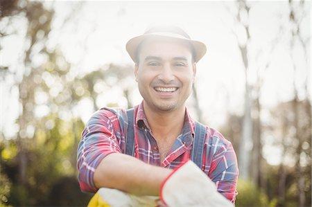 Gardener man posing with his rake in the garden Stock Photo - Premium Royalty-Free, Code: 6109-08489105