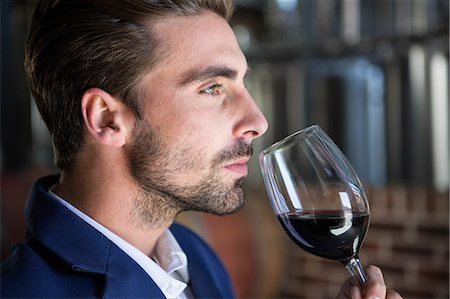 seasonal - Well dressed man examining glass of wine at the winefarm Stock Photo - Premium Royalty-Free, Code: 6109-08489557