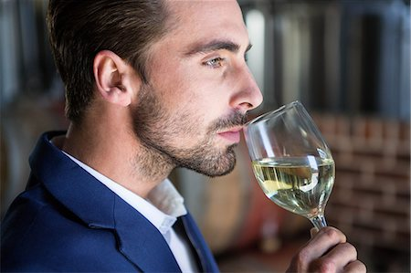 seasonal - Well dressed man examining glass of wine at the winefarm Stock Photo - Premium Royalty-Free, Code: 6109-08489555