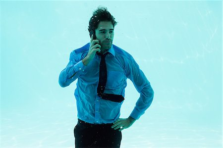 pool - Businessman on the phone underwater in swimming pool Stock Photo - Premium Royalty-Free, Code: 6109-08489777