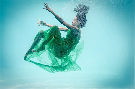 photography - Brunette in evening gown swimming in pool underwater Stock Photo - Premium Royalty-Free, Code: 6109-08489774