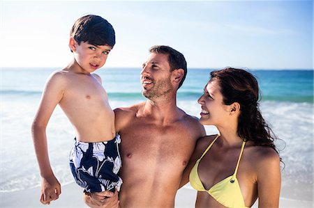 Cute couple carrying their son on the beach Stock Photo - Premium Royalty-Free, Code: 6109-08434847