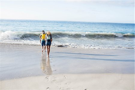 Parents giving piggy back to their children on the beach Stock Photo - Premium Royalty-Free, Code: 6109-08434872