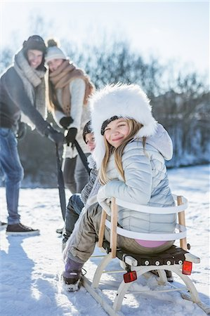 fluffy - Portrait of family playing with sled on a beautiful snowy day Stock Photo - Premium Royalty-Free, Code: 6109-08435861