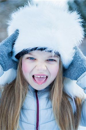 fur - Cute girl sticking out her tongue on a beautiful snowy day Stock Photo - Premium Royalty-Free, Code: 6109-08435824