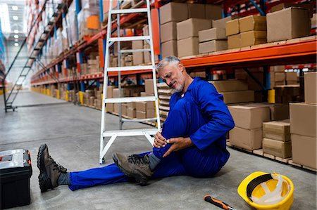 dangerous accident - Worker lying on the floor Stock Photo - Premium Royalty-Free, Code: 6109-08581599