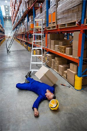 dangerous accident - Unconscious worker lying on the floor Stock Photo - Premium Royalty-Free, Code: 6109-08581605