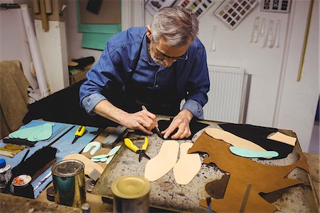 High angle view of cobbler making shoes Stock Photo - Premium Royalty-Free, Code: 6109-08582144