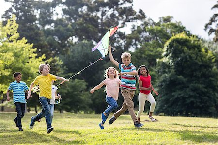 Happy children playing with a kite Stock Photo - Premium Royalty-Free, Code: 6109-08536434