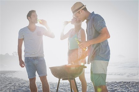 Cute group of friends having a barbecue and beers Stock Photo - Premium Royalty-Free, Code: 6109-08536834