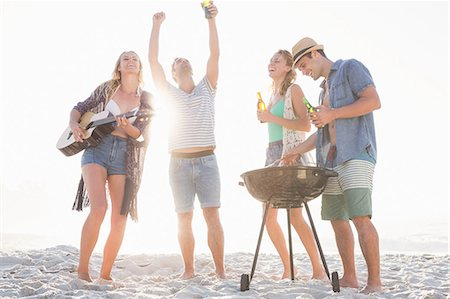 fit people - Cute group of friends having a barbecue and beers and playing the guitar Stock Photo - Premium Royalty-Free, Code: 6109-08536836
