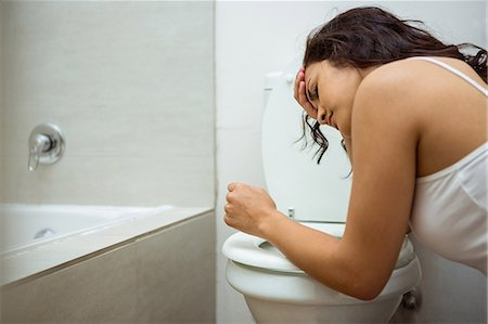 poison - Young woman about to vomit into a commode toilet Stock Photo - Premium Royalty-Free, Code: 6109-08536959