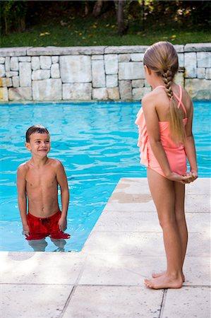 Siblings standing at swimming pool Stock Photo - Premium Royalty-Free, Code: 6109-08537085