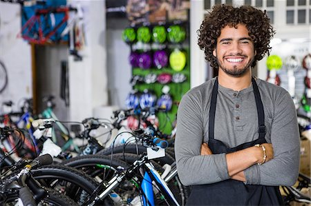 Cheerful bike dealer crossing arms Stock Photo - Premium Royalty-Free, Code: 6109-08537308
